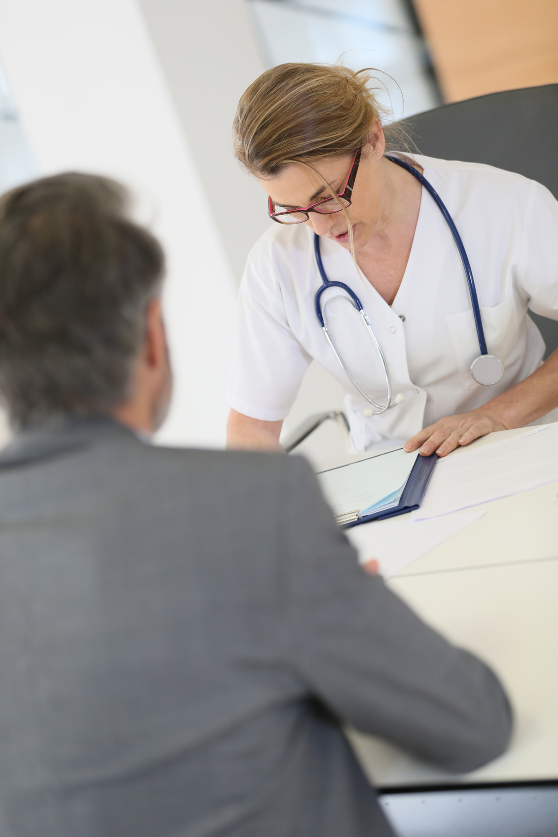 Doctor meeting with patient in hospital office